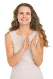 Smiling young woman applauding Royalty Free Stock Image