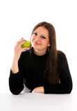 Smiling young woman with apple Stock Photo