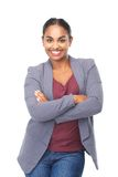 Smiling young woman with arms crossed Royalty Free Stock Photography