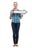 Smiling young woman with arrow poiting Royalty Free Stock Image