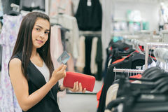 Smiling young woman Asian with shopping and buy with credit card. At mall/supermarket/market Stock Image
