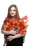 Smiling young woman with autumn maple leaves. Isolated on white background royalty free stock image