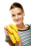 Smiling young woman with banana Royalty Free Stock Image