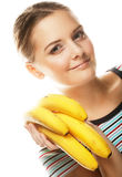 Smiling young woman with banana Royalty Free Stock Images