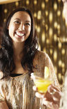 Smiling Young Woman At The Bar Royalty Free Stock Photos