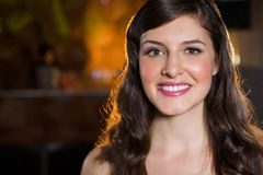 Smiling young woman in bar Royalty Free Stock Photography