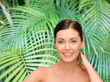 Smiling young woman with bare shoulders Stock Photo