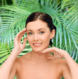Smiling young woman with bare shoulders Royalty Free Stock Photography