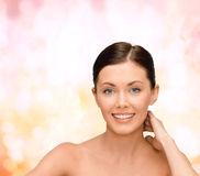 Smiling young woman with bare shoulders Stock Photography
