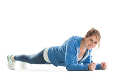 Smiling young woman in basic plank posture Royalty Free Stock Photos