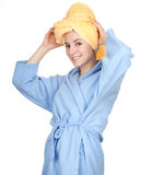 Smiling young woman in bathrobe Stock Photography