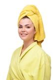 Smiling young woman in bathrobe and towel Stock Photography
