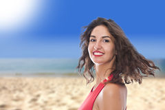 Smiling young woman on the beach Stock Photos