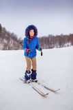 Smiling young woman beginner skier in winter Stock Photo