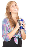 Smiling young woman with big blue cup Royalty Free Stock Photo