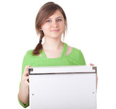 Smiling young woman and big white box Stock Image