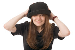 Smiling young woman in black hat Stock Images