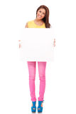 Smiling young woman with blank bill board Royalty Free Stock Photo