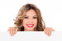 Smiling young woman with a blank billboard Royalty Free Stock Photography
