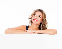 Smiling young woman with a blank billboard Stock Photos