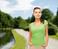 Smiling young woman in blank green t-shirt Stock Photography