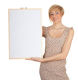 Smiling young woman with blank sign, billboard Royalty Free Stock Image