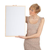 Smiling young woman with blank sign, billboard Stock Images
