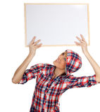 Smiling young woman with blank sign, billboard Stock Photo