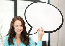 Smiling young woman with blank text bubble Stock Photo