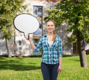 Smiling young woman with blank text bubble Royalty Free Stock Photography