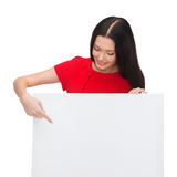 Smiling young woman with blank white board Stock Photos