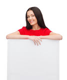 Smiling young woman with blank white board Royalty Free Stock Images