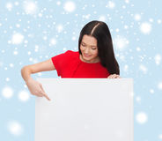 Smiling young woman with blank white board Stock Images