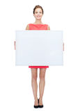 Smiling young woman with blank white board Royalty Free Stock Photography