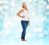 Smiling young woman in blank white shirt and jeans Stock Image
