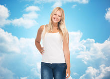 Smiling young woman in blank white shirt and jeans Royalty Free Stock Photo