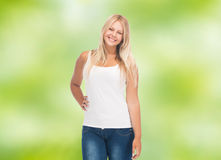 Smiling young woman in blank white shirt and jeans Royalty Free Stock Images
