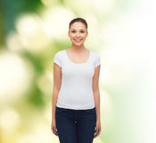 Smiling young woman in blank white t-shirt Royalty Free Stock Photos