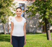 Smiling young woman in blank white t-shirt Royalty Free Stock Images