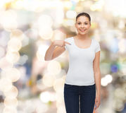 Smiling young woman in blank white t-shirt Royalty Free Stock Image