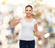 Smiling young woman in blank white t-shirt Stock Images