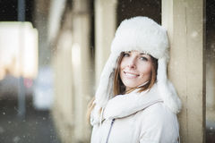 Smiling young woman in blizzard Royalty Free Stock Images