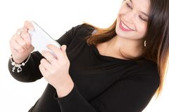 Smiling young woman Blogger Text Messaging On Mobile Phone. A Smiling young woman Blogger Text Messaging On Mobile Phone royalty free stock photo