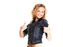 Smiling young woman blonde in jeans tumb up Stock Image