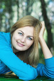 Smiling young woman with blue eyes outdoors Royalty Free Stock Photo