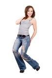 Smiling young woman in a blue jeans. Isolated royalty free stock photos