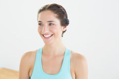 Smiling young woman in blue sports bra Royalty Free Stock Images
