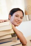 Smiling young woman with books Royalty Free Stock Images
