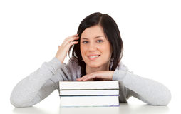 Smiling young woman and books Stock Photo
