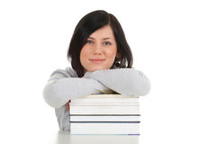 Smiling young woman and books Royalty Free Stock Photo